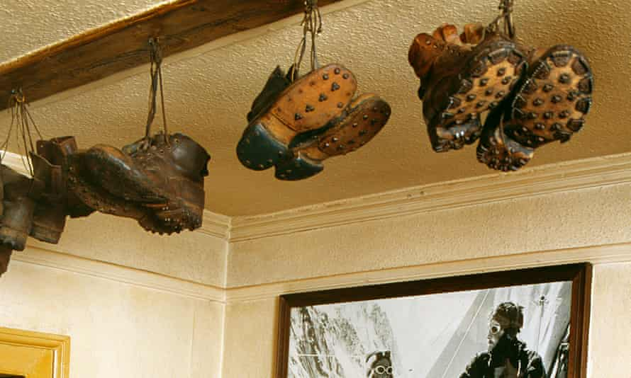 Hobnail boots hanging from the ceiling of a bar at The Pen-y-Gwryd Hotel