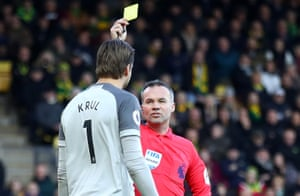 Referee Paul Tierney issues Krul a yellow card.