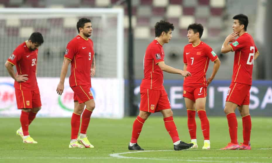 Dejection for China, including for two of the team's naturalised players, Aloísio (left) and Ai Kesen (second left), after September's defeat by Japan in a World Cup qualifier.