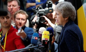 Theresa May speaking to reporters at the start of the EU summit in Brussels.