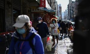 People walk in the Chinatown area of New York City on 5 February.