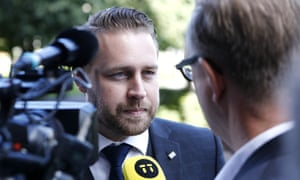 Mattias Karlsson, leader of the Sweden Democrats parliamentary group, talks to reporters.