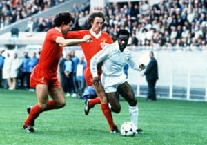 Laurie Cunningham was tightly marked throughout. Here he is marshalled by Phil Neal and Souness
