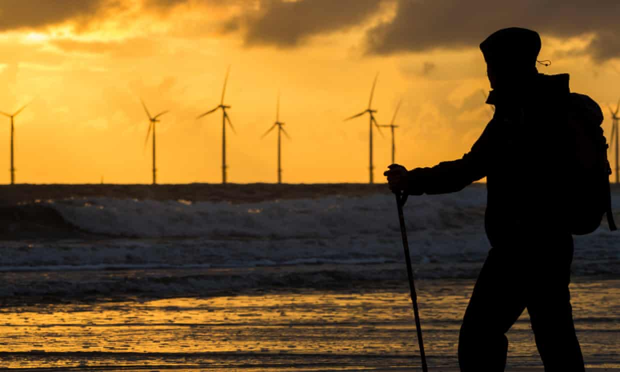A female walker on Seaton Carew beach. The PM will compare the UK's offshore wind resources to Saudi oil wealth at the Tory conference. Photograph: AJ D Foto Ltd/Alamy