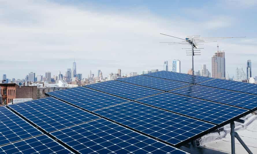 solar panels on a brooklyn roof with the manhattan skyline in the background