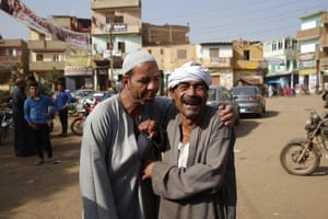 Two locals share a joke as they arrive at a polling station in el-Menofeyya, Egypt, to cast their votes in the second phase of the parliamentary elections