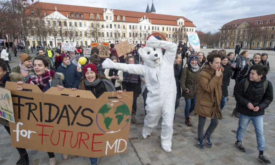 Students protest for climate action during a 'Fridays for Future' school strike in Magdeburg, Germany.