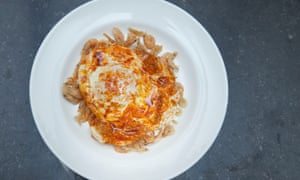 Scene-shifting cuisine: camarones fritos topped with a runny fried egg, Sabor Restaurant, London