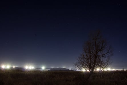 'Floodlights point at the camp from dusk until dawn'.