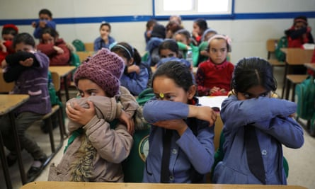 Syrian refugee students take part in an awareness campaign about coronavirus initiated by Oxfam and Unicef at Zaatari refugee camp in Jordan.
