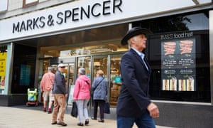Exterior of Marks & Spencer Darlington with a man in a hat walking past
