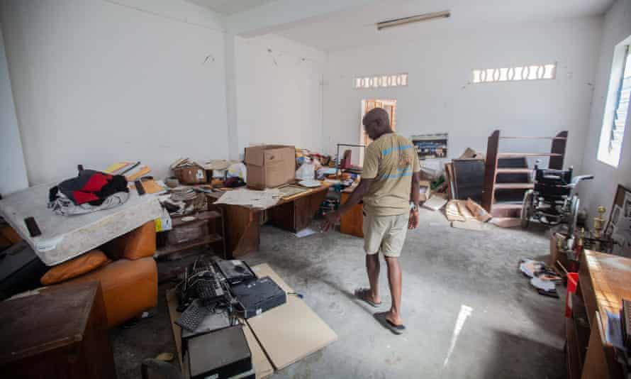 A worker assesses the damage to the Lycee Phillipe Guerrier after the earthquake in Les Cayes, Haiti.