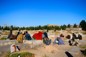 Addicts smoke opium in a cemetery in Herat, Afghanistan.