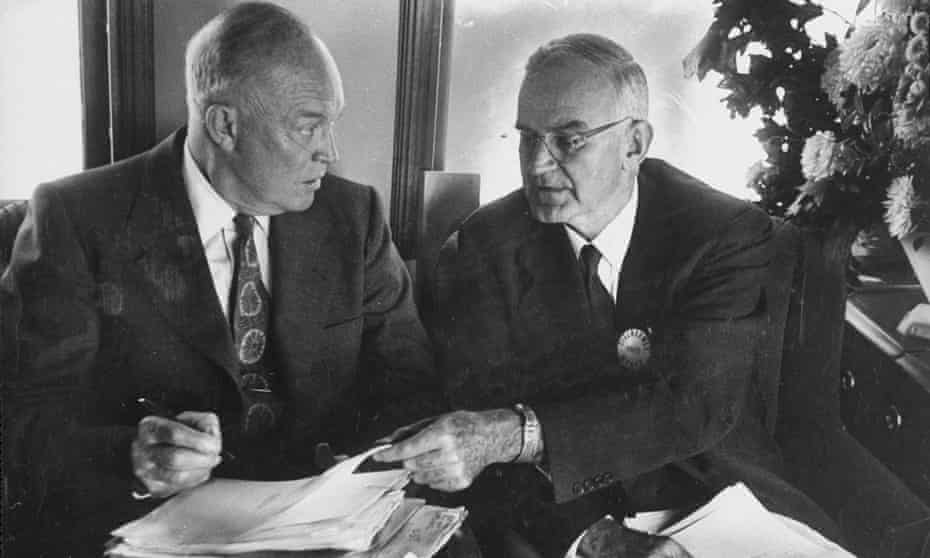 Dwight D Eisenhower (L) works with his personal secretary Robert Cutler.