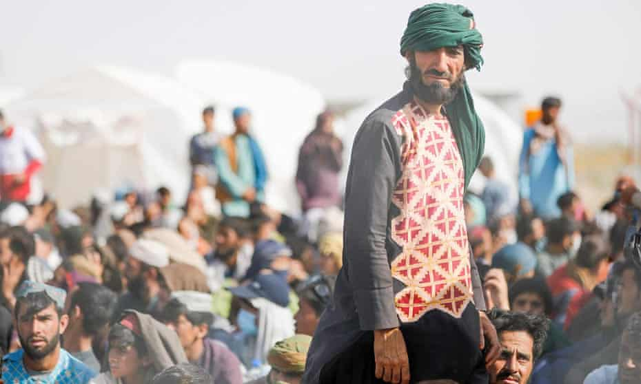 Afghan refugees gather at the Iran-Afghanistan border in Sistan and Baluchistan province as they try to enter the Islamic republic