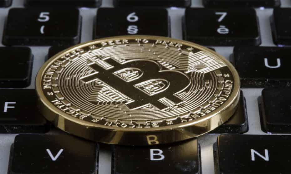 A visual representation of the digital cryptocurrency, Bitcoin, on a keyboard.