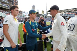 Australia's Tim Paine and England's Joe Root shake hands after the match.