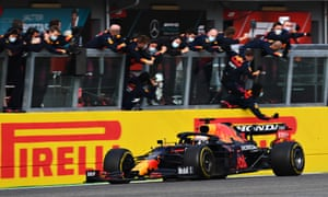 Max Verstappen passes his team celebrating on the pitwall
