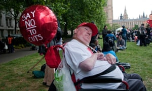 A protest outside the Houses of Parliament by disabled people against social services cuts.