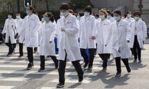 Medical workers from Beijing walk near a park during a day off as the city of Wuhan slowly loosens up ahead of a lifting of the two month long lockdown in central China's Hubei province on Sunday, 5 April, 2020.