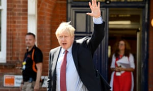 Boris Johnson waving as he leaves following a visit to Torbay Hospital.