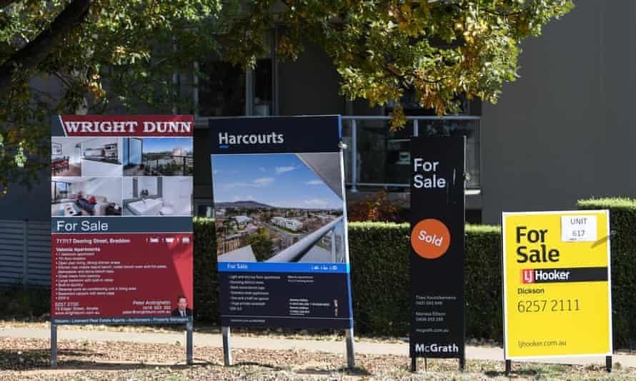 For sale signs outside an apartment block in Canberra