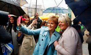 Nicola Sturgeon posing for a selfie while campaignin in Hamilton town centre.