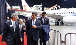 Chinese president Xi Jinping, second from right, and president and CEO of Boeing Commercial Airplanes Ray Conner tour the Boeing assembly line.