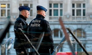Police officers stand in front of the courthouse in Brussels during the trial of Mehdi Nemmouche