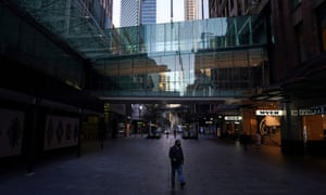 A man wears a protective face mask at the unusually quiet Pitt Street Mall in the City Centre of Sydney, during a lockdown to curb the spread of the coronavirus.