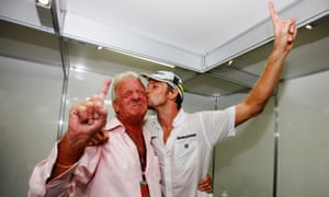 Celebrating his 2009 world title with his father John