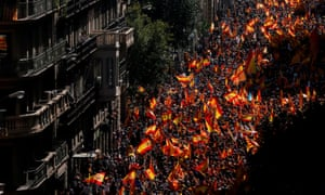 Protesters hold Spanish flags during a demonstration against secession on 8 October in Barcelona.