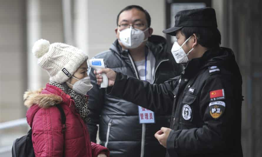 Temperature checks in Wuhan, China, in January 2020.