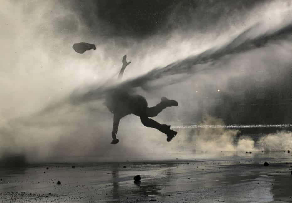 An anti-government demonstrator is sprayed by a police water cannon during a protest in Santiago, Chile, on 9 December.