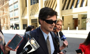 Christopher Fotis runs a media gauntlet after giving evidence at the royal commission regarding an assault on a boy during his time as a Knox grammar house master.