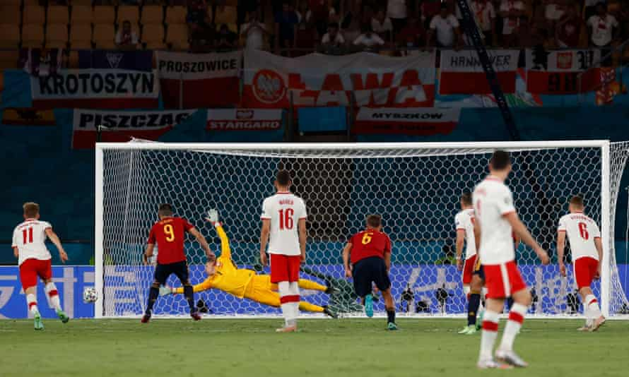Spaniard Gerard Moreno (second from left) watches his penalty return to the post.