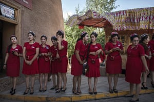 Uyghur tourist guides wait to perform in a show for Chinese tourists