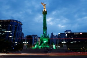 Green lights are projected at the Angel of Independence monument in Mexico City in support of the Paris climate agreement