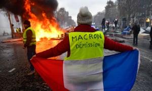 The 'gilets jaunes' protest against rising fuel prices in Paris, 24 November.