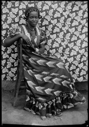 Untitled, 1958 Seated woman in dress before patterned backdrop