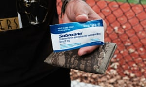 A heroin user holds Suboxone