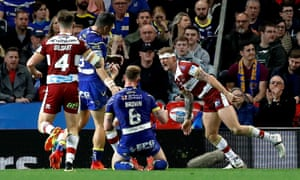 Wigan Warriors' Dominic Manfredi (right) celebrates scoring his team's third, and his second, try of the game.