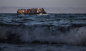 Refugees and migrants in a dinghy approaching the Greek island of Lesbos