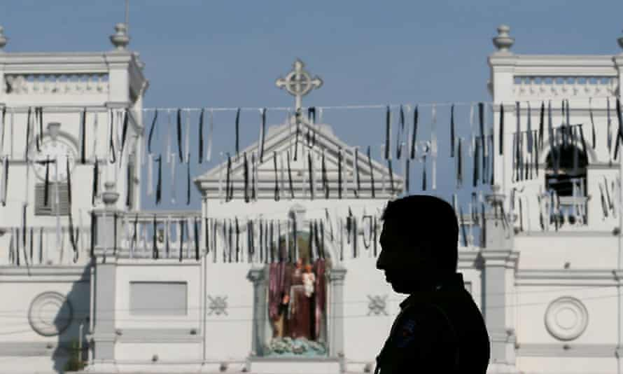 Security personnel observe three-minute silence in Colombo