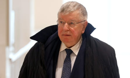 Didier Lombard, former CEO of France Télécom, arrives at the Paris criminal court.