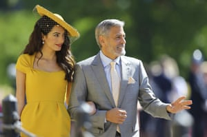 Amal Clooney and George Clooney arrive for the wedding ceremony of Prince Harry and Meghan Markle.