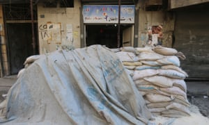 Sandbags protect the entrance of a children's hospital in Aleppo.