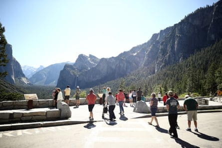 People congregate at the Tunnel View lookout in Yosemite national park.