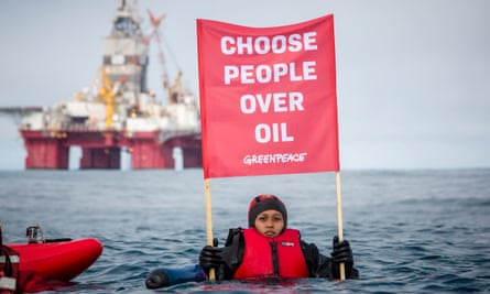 A Greenpeace protester opposing the Statoil Songa Enabler oil rig north of the Norwegian coast.