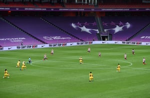 The players take a knee in support of Black Lives Matter.